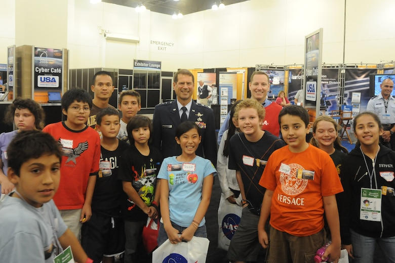 Lt. Gen. Tom Sheridan, SMC commander, visits with a group of school children touring Education Alley during AIAA's Space 2009 Conference in Pasadena, Sept. 17.  (Photo by Atiba S. Copeland)