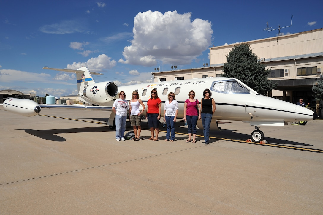 Left to right, Paula Tootle, Denise Meika , Anna Morgan, Melisa Danielson, Rebecca Stumpf and Liz Rohrer pose with a C-21 flown by the 200th Airlift Squadron out of Buckley Air Force Base, September 20, 2009.  The Colorado Air National Guard is honoring its spouses this week in appreciation of all their support by giving them incentive flights in a C-21 over the state of Colorado. (U.S. Air Force photo by Tech. Sgt. Wolfram M. Stumpf, Colorado Air National Guard/Released)
