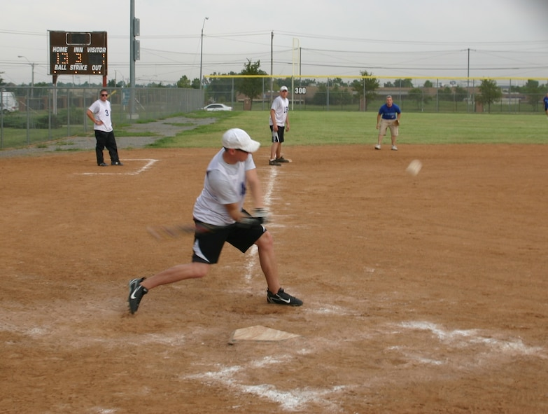 The American and Canadian teams competed in an American favorite, softball on September 9. Despite the Canadian team's valiant effort, the American team won the game, 27 to 8. Photo courtesy of Mr. Kenneth LaFayette.