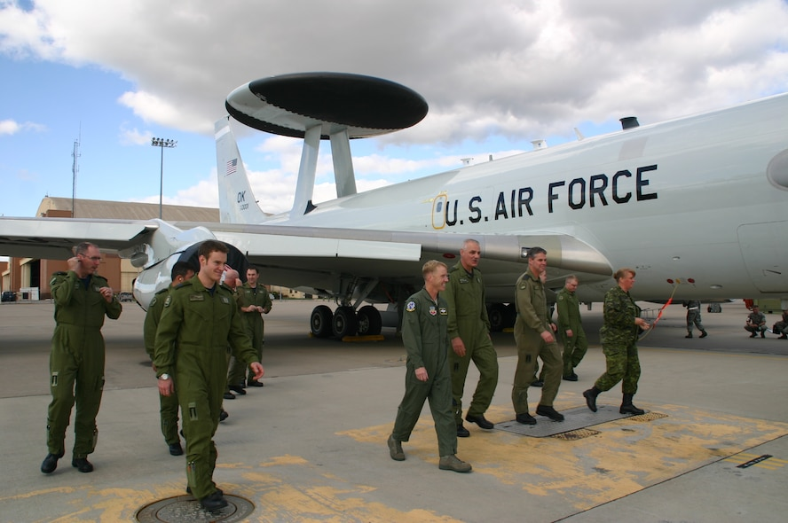 Col. Scott Forest, vice commander, 552 ACW, walks away from the jet with his fellow crewmembers after taking distinguished visitor, Maj. Gen. Pierre Forgues, NORAD J3, Canadian Forces, on an orientation flight September 22. The crew for the sortie was composed of almost entirely Canadians, a first in 552 ACW history. Photo courtesy of 1st Lt. Kinder Blacke.