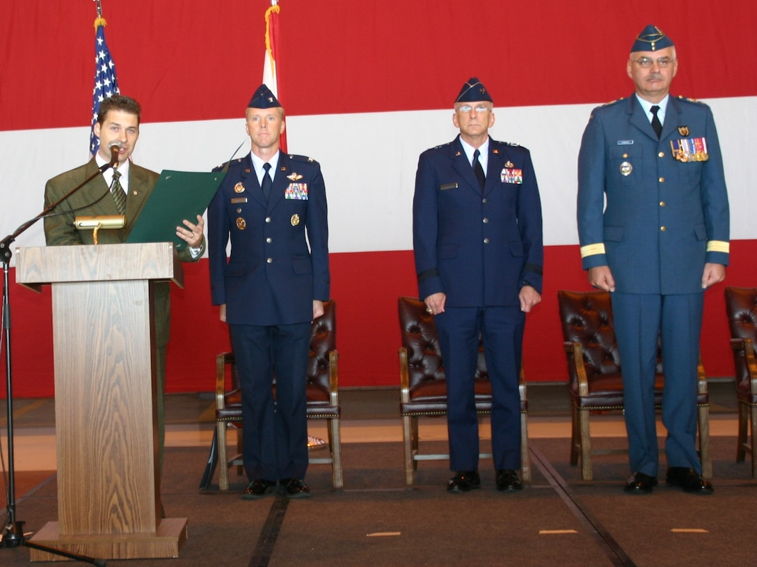 Representative Shane Jett reads the 30th Anniversary Canadian-American Partnership Proclamation during an official ceremony September 23. To his side are Col. Scott Forest, vice commander, 552 ACW, Maj. Gen. David Gillett, commander, OC-ALC, and Maj. Gen. Pierre Forgues, NORAD J3, Canadian Forces. Photo courtesy of 1st Lt. Kinder Blacke.