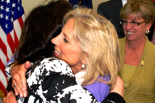 Dr. Jill Biden, wife of Vice President Joe Biden, hugs Theresa Martel, whose husband, Army 1st Sgt. Joseph Martel, is deployed with the New York National Guard's 206th Military Police Company in Basra, Iraq, as Susan Taluto, wife of Army Maj. Gen. Joseph J. Taluto, the New York National Guard adjutant general, looks on in Latham, N.Y., Sept. 21, 2009. (U.S. Army photo/Lt. Col. Paul Fanning)