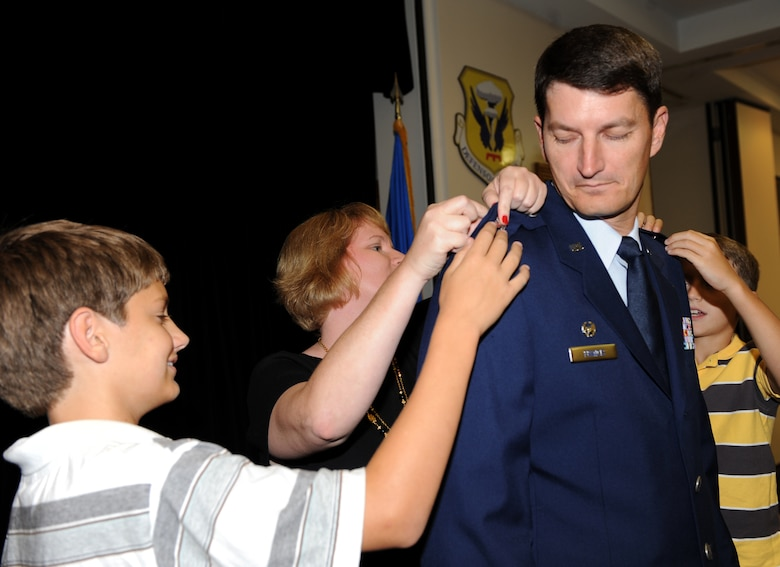 WHITEMAN AIR FORCE BASE, Mo. – Lt. Col. Michael Francis, 131st Operations Group commander, receives his promotion to the rank of colonel as his family pins on his rank, Sept. 23. The rank of colonel is a senior field grade military officer rank just above the rank of lieutenant colonel and just below the rank of brigadier general.  (U.S. Air Force photo/Senior Airman Cory Todd)