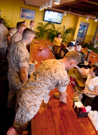 CAMP H.M. SMITH, Hawaii - U.S. Marine Corps Forces, Pacific Headquarters Battalion Marines order drinks and food during a Professional Military Education class Sept. 25, at the Sunset Lanai. The PME was held by MarForPac Sgt. Maj. James Futrell, sergeant major, MarForPac, to talk with Marines about the Marine Corps, current efforts, and answered questions at the end. Futrell used the PME as a orientation to speak with Marines since assuming command roughly two months ago. (Official U.S. Marine Corps photo by Cpl. Achilles Tsantarliotis)(Released)