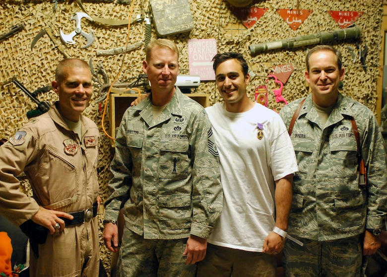 Tech. Sgt. Richard Gibbons (center right), 140th Civil Engineering Explosive Ordnance Disposal Flight, is awarded a Purple Heart medal Sept. 19, 2009, at Bagram Air Base, Afghanistan. His vehicle was hit by a rocket-propelled grenade while on a mounted patrol in Afghanistan earlier in the week. (Courtesy photo)