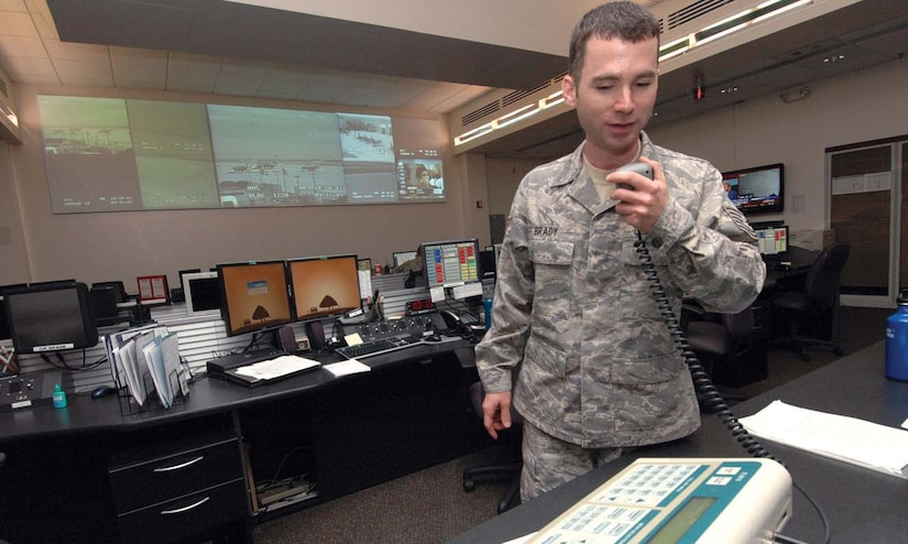 Technical Sgt. Joseph Brady, NCO in charge of console operations for the Andrews Regional Command Post and 316th Wing Command Post, uses the Giant Voice machine to conduct a random test from inside the Base Operations Command Post building. The command post uses the Giant Voice for mass alert should the base come under threat of attack or natural disaster.(U.S. Air Force photo/ Bobby Jones)