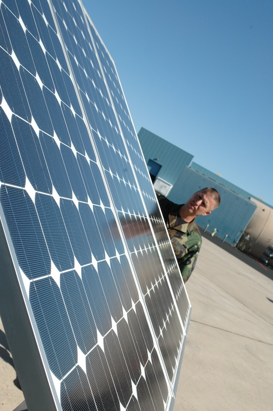 Tech. Sgt. Martin Buelow, a power support systems mechanic with the 162nd Fighter Wing's Aerospace Ground Equipment shop, sets up a mobile solar flood light near the flightline at Tucson International Airport, Sept. 24. Solar-powered lighting will reduce the wing's annual energy consumption saving money and the environment. (Air National Guard photo by Maj. Gabe Johnson)