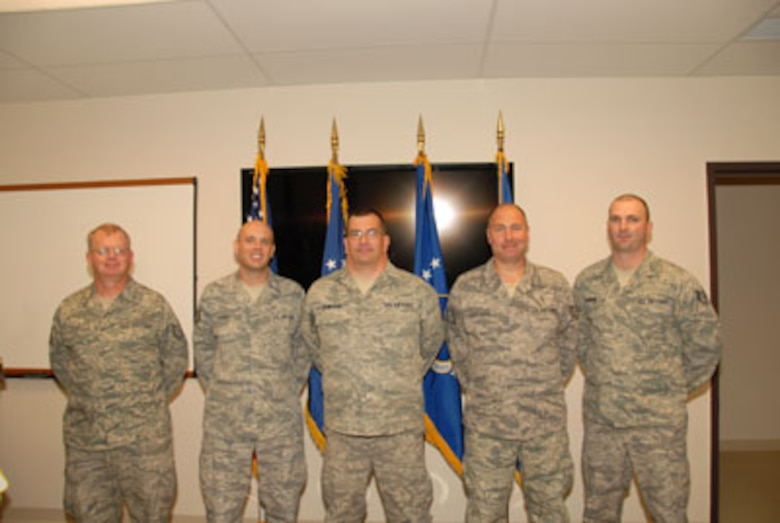 Technical Sgt. Mark Raut, Technical Sgt. Steven Sobus, Master Sgt. Dan Olmstead, 174FW MQ-9 Ground Control Station maintenance instructor, Technical Sgt. William Clochessy and Staff Sgt. Shawn Badman pose for a class photo on the 24th of September as part of the first graduating class of the Ground Control Station maintenance course held here at Hancock Field Air National Guard Base. (U. S. Air Force photo by Staff Sgt. Barbara Olney/RELEASED)