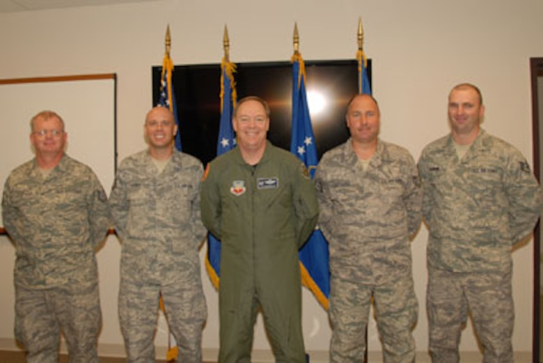 Technical Sgt. Mark Raut, Technical Sgt. Steven Sobus, Col. Kevin W. Bradley, 174FW Commander, Technical Sgt. William Clochessy and Staff Sgt. Shawn Badman pose for a class photo on the 24th of September as part of the first graduating class of the Ground Control Station maintenance course held here at Hancock Field Air National Guard Base. (U. S. Air Force photo by Staff Sgt. Barbara Olney/RELEASED)