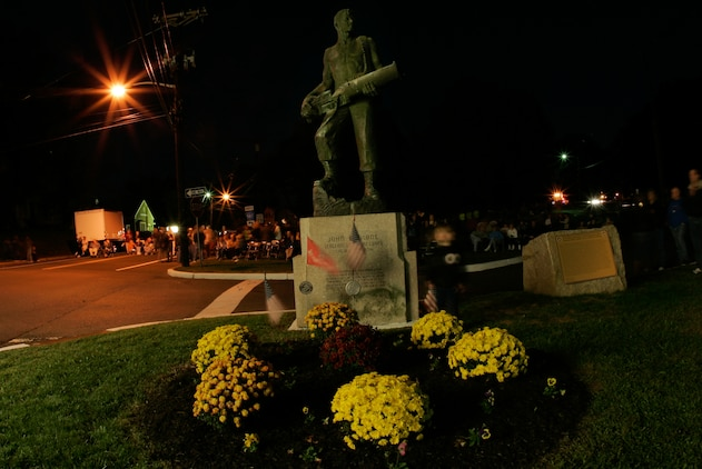 A crowd gathers in Raritan, N.J., at the John Basilone Statue for a concert and fireworks, Sept. 26. The hometown of the Medal of Honor and Navy Cross recipient has been honoring his legacy with a weekend celebration for 28 years. (Marine Corps photo by Sgt. Randall A. Clinton)
