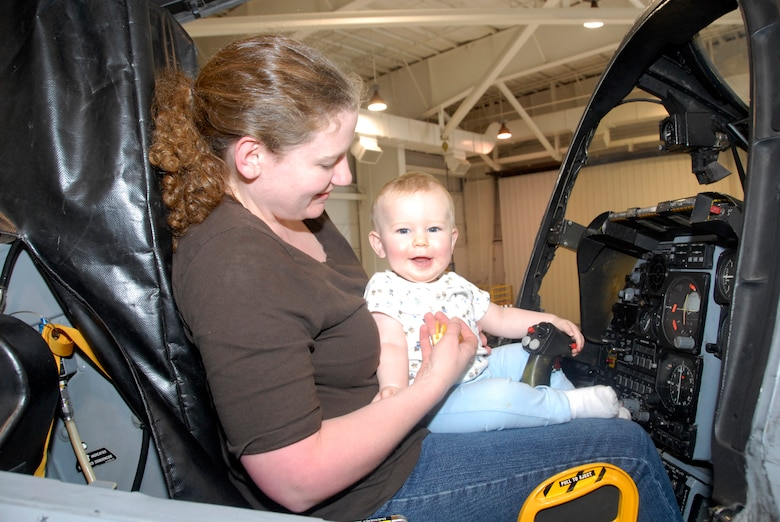 Family members of deployed reservists from the 442nd Fighter Wing's 442nd Security Forces Squadron were the guests of honor at a Yellow Ribbon Program event at Whiteman Air Force Base, Mo., Sep 26.  Here, Rose and her 1-year-old son, Scott, tour the cockpit of an A-10 Thunderbolt II in the wing's 5-Bay Hangar.  In addition to tours, the event featured forums for spouses and family members on topics such as marriage enrichment, post-traumatic stress disorder, financial management and stresses caused by multiple deployments.  The Yellow-Ribbon Program is designed to assist military members and their families deal with the rigors of reintegration following an extended combat deployment.  The 442nd SFS deploys more than any other unit in the 442nd FW, with Air Force reservists currently deployed to Kirkuk Air Base, Iraq.  The 442nd Fighter Wing is an Air Force Reserve Command unit based at Whiteman.  (U.S. Air Force photo/Maj. David Kurle)