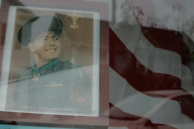 A storefront displays a picture of Sgt. John Basilone along with an American Flag in Raritan, N.J., Sept 27. This small, 7,000-person town host the largest military parades and one of the only in tribute to an enlisted Marine. Basilone received the Medal of Honor for his actions keeping multiple heavy machine guns firing to repel an overwhelming Japanese assault at Guadalcanal. (Marine Corps photo by Sgt. Randall A. Clinton)