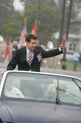 "Actor Jon Seda waves from the motorcade leading the John Basilone Parade in Raritan, N.J., Sept. 27. Seda will play John Basilone, a native Marine Medal of Honor and Navy Cross recipient, in the upcoming HBO miniseries ""The Pacific.""(Marine Corps photo by Sgt. Randall A. Clinton)"