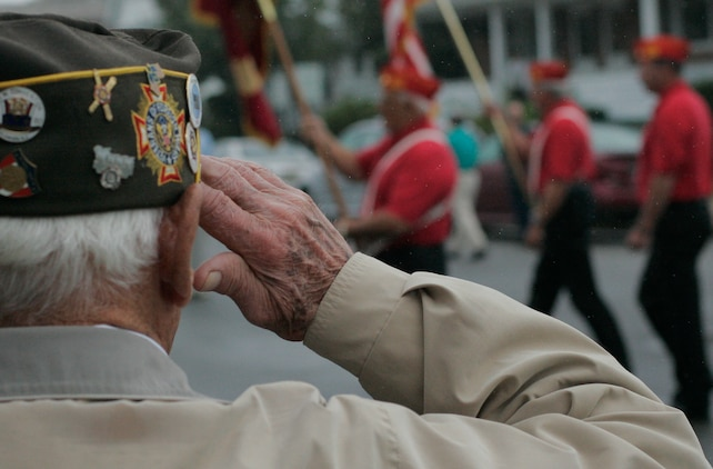 Joeseph Kovac, a retired sailor and Veterans of Foreign Wars past commander, salutes one of many color guards in the John Basilone Parade in Raritan, N.J., Sept. 27. The parade is the largest military parade in the nation and honors Basilone, a native Marine hero. (Marine Corps photo by Sgt. Randall A. Clinton)