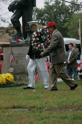 Donald Basilone, younger brother to John, carrys a wreath to the John Basilone Statue in Raritan, N.J., Sept 27. The celebration of the town's Medal of Honor recipient is the largest military parade in the nation.(Marine Corps photo by Sgt. Randall A. Clinton) ::r::::n::