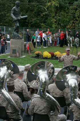 The Quantico Marine Corps Band performs during the wreath laying ceremony at the John Basilone Statue in Raritan, N.J., Sept. 27. The celebration of the town's Medal of Honor recipient is the largest in the nation. (Marine Corps photo by Sgt. Randall A. Clinton)