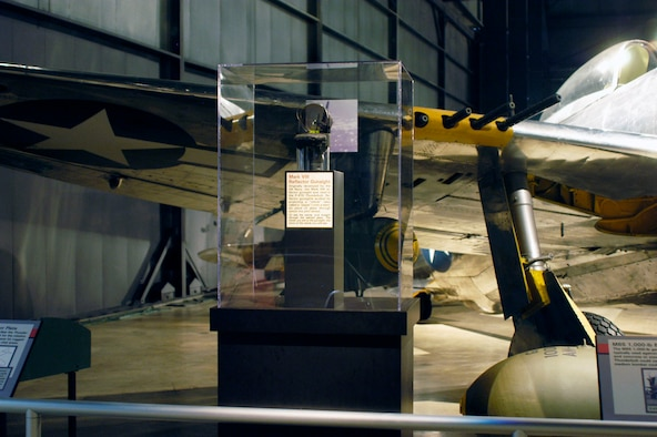 "DAYTON, Ohio -- Mark VIII Reflector Gunsight on display in the World War II Gallery at the National Museum of the U.S. Air Force. Originally developed by the U.S. Navy, the Mark VIII reflector gunsight was used in the P-47D Thunderbolt. Reflector gunsights worked by projecting a ""reticle"" (also called a ""pipper"") onto a slanted piece of glass through which the pilot aimed. (U.S. Air Force photo)"