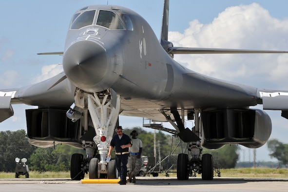 EGLIN AIR FORCE BASE, Fla. -- Staff Sgt.(s) Dallas Osburn and Jerome Smith, 337th Test and Evaluation Squadron, wait for their B-1B Lancer to taxi for a test mission Sept. 24 here. Two B-1s were brought from Dyess Air Force Base, Texas, for test missions last week in an effort to better defend the aircraft for today's warfighters and prove the strength of new software. The B-1 is a long range, multi-role, heavy bomber with a wingspan of 137 feet, and is capable of intercontinental flight unrefueled. (U.S. Air Force photo/ Airman Anthony Jennings)