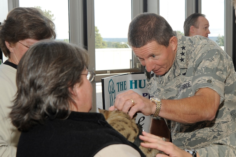 Air Force Academy superintendent Lt. Gen. Mike Gould visits representatives from the Humane Society of the Pikes Peak Region during the Combined Federal Campaign kickoff at the Academy Sept. 22, 2009. The Humane Society was one of about 40 CFC charities in attendance at the kickoff event. (U.S. Air Force photo/Rachel Boettcher)