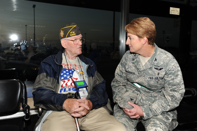 Col. Kathleen Concannon, 319th Medical Group commander, talks with Beno Kofstad, a veteran participating in the Northern Valley Honor Flight, Sept. 25at Grand Forks International Airport. Mr. Kofstad served as a Merchant Marines in the Pacific on the Tanker USS Illinois during World War II. The Northern Valley Honor Flight gives WWII veterans a chance to see their memorial as well as other memorials in the nation's capitol. (U.S. Air Force photo by Staff Sgt. Suellyn F. Nuckolls)