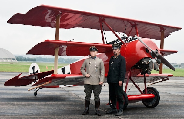 DAYTON, Ohio -- Reenactors stand in front of a Fokker Dr. I during the World War I Dawn Patrol Rendezvous at the National Museum of the U.S. Air Force. (U.S. Air Force photo)