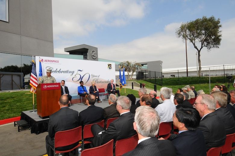 SMC Commander Lt. Gen. Tom Sheridan addresses the crowd at the pedestrian bridge opening ceremony, Sept. 29.  Spanning El Segundo Blvd., the new bridge links Los Angeles Air Force Base and The Aerospace Corporation facilities. (Photo by Lou Hernandez)