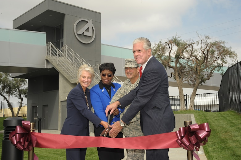 From left to right, Congresswoman Jane Harmon, Aerospace Corporation CEO Dr. Wanda Austin, SMC Commander Lt. Gen. Tom Sheridan and El Segundo Mayor Kelly McDowell cut the ribbon to officially open the new pedestrian bridge linking Los Angeles Air Force Base and The Aerospace Corporation facilities, Sept. 29. (Photo by Lou Hernandez)