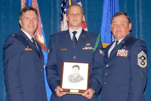 McGHEE TYSON AIR NATIONAL GUARD BASE, Tenn. -- Senior Airman James K. Parmentier, a guidance and control systems avionics technician with the 129th Rescue Wing, California Air National Guard, receives the John L. Levitow Honor Award for Airman Leadership School Class 09-5 at The Air National Guard Training and Education Center here from Col. Richard B. Howard and Chief Master Sgt. James B. Long, Sept. 10, 2009.  The John L. Levitow Award is the highest honor awarded a graduate of any Air Force enlisted professional military education course.  (U.S. Air Force photo by Master Sgt. Kurt Skoglund)(Released)
