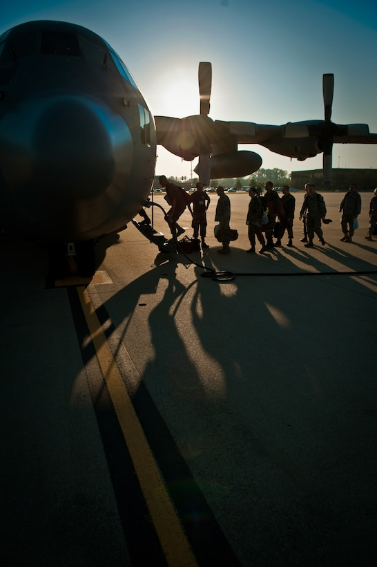Members of the 123rd Airlift Wing board a C-130 aircraft at the Kentucky Air National Guard Base in Louisville, Ky., on Sept. 12. The troops are part of about 100 Kentucky Air Guardsmen will be supporting U.S. Southern Command airlift operations from San Juan, Puerto Rico, through Oct. 10 for Operation Coronet Oak. (U.S. Air Force photo/Maj. Dale Greer)
