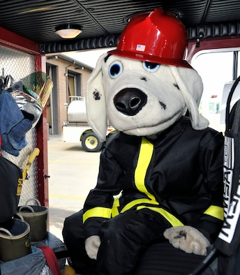 Airman 1st Class Curtis Sinkfield, 19th Civil Engineering Squadron fire fighter, takes time to pose as Sparky inside a fire truck.  The fire truck Sparky's in is the first fire truck to be called to any fire incident on base. (U.S. Air Force photo by Airman 1st Class Lausanne Pacheco)