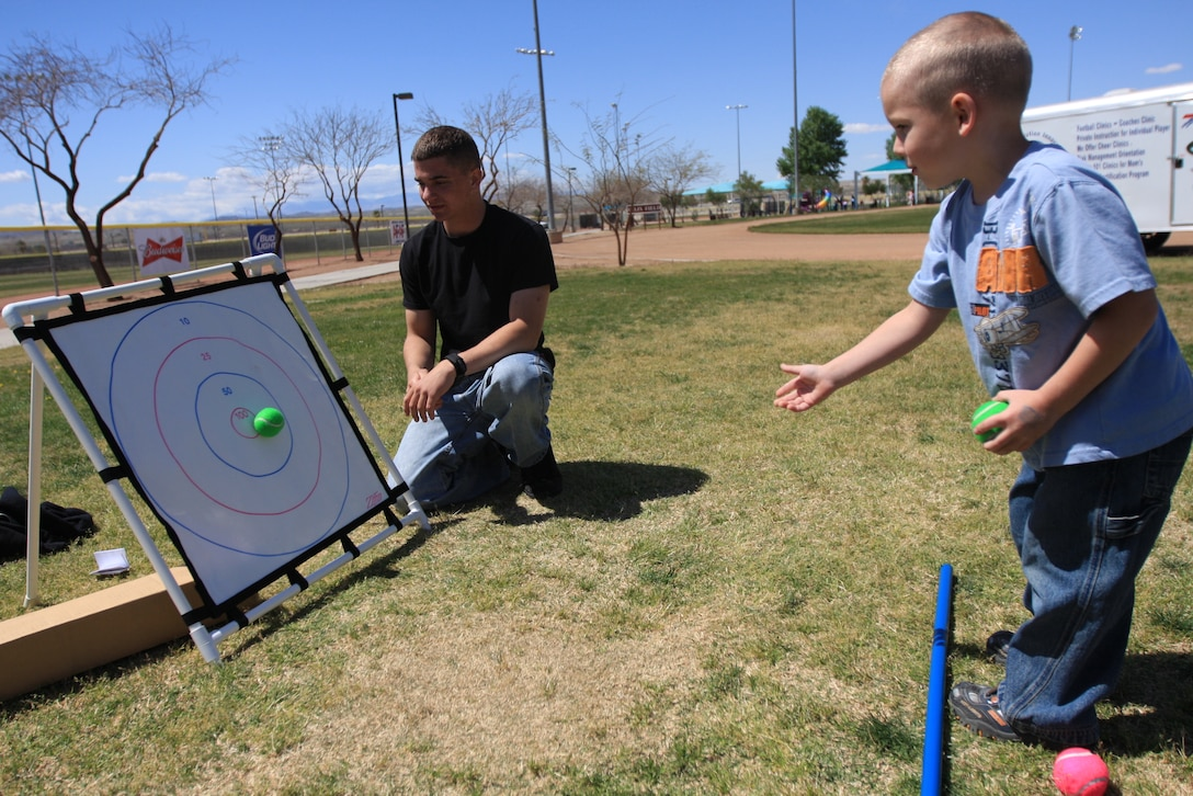 Ethan Dixon, 4, whose father is deployed to Afghanistan with 3rd Battalion, 4th Marine Regiment, hits a bull's-eye while playing the target game during the Month of the Military Child Carnival April 1 at Felix Field.