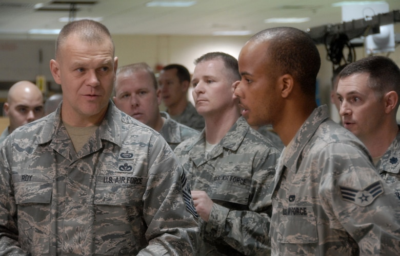 Chief Master Sgt. of the Air Force James A. Roy (left) asks Senior Airman Dussie Poole a question about electronic warfare pods March 18, 2010, at Eglin Air Force Base, Fla. Chief Roy's two-day visit to the base included tours of units within the various wings and speaking with junior enlisted and senior leadership on Air Force issues. Airman Poole is assigned to the 16th Electronic Warfare Squadron. (U.S. Air Force photo/Samuel King Jr.)