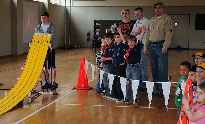 BITBURG ANNEX, Germany -- Nathan Davis cheers as his pinewood derby car wins four consecutive heats March 27.  Nathan advanced to the next round to compete for the annual Pinewood Derby title. (U.S. Air Force photo/Staff Sgt. Heather M. Norris)