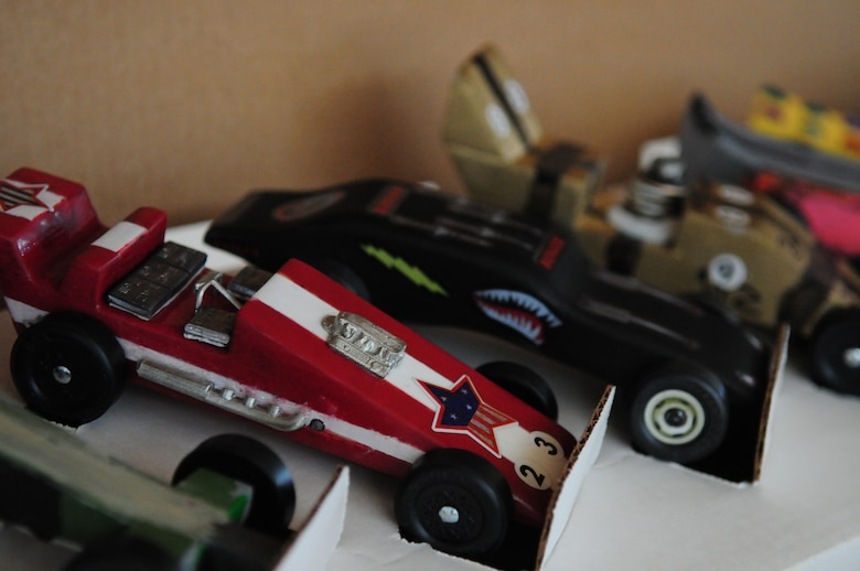 BITBURG ANNEX, Germany -- Various pinewood derby cars sit on display March 27.  Various dens from Boy Scout pack 161 competed for the annual Pinewood Derby title. (U.S. Air Force photo/Staff Sgt. Heather M. Norris)