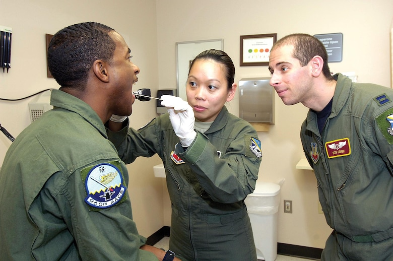 Flight surgeon Capt. Seth Cohen and medical technician Staff Sgt. Irene Williams are part of the flight medicine team who sees to the health needs of approximately 2,000 flight crew members at Tinker. Flight Medicine also responds to every in-flight emergency called on base. (Air Force photo by Margo Wright)