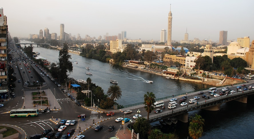 Cars crisscross through the inner city of Cairo Egypt, alongside the Nile River during the day.  Cairo is the capital of Egypt and the largest city in Africa as well as one of the most densely populated cities in the world. Cairo is the center of the region's political and cultural life and is largely associated with Ancient Egypt due to the proximity of the Great Sphinx and the Pyramids of Giza. (U.S. Air Force photo/Senior Airman Sara Csurilla)