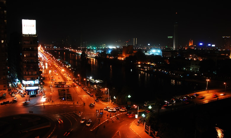 Cars crisscross through the inner city of Cairo Egypt, alongside the Nile River at night.  Cairo is the capital of Egypt and the largest city in Africa as well as one of the most densely populated cities in the world. Cairo is the center of the region's political and cultural life and is largely associated with Ancient Egypt due to the proximity of the Great Sphinx and the Pyramids of Giza. (U.S. Air Force photo/Senior Airman Sara Csurilla)