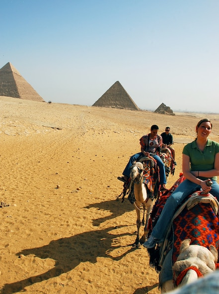 Tourists ride camels through the Sahara Desert by the Pyramid of Khufu and the Pyramid Khafre. The Pyramid of Menkaure is placed right next to these two and they are known as the Pyramids of Giza. The Pyramids of Giza are believed to have been built around 2500 B.C. and are known as one of the Seven Wonders of the World. (U.S. Air Force photo/Senior Airman Sara Csurilla)