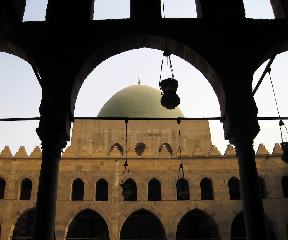 The top of part of the Mosque of Muhammad Ali, regarded as the founder of modern Egypt, is framed by two pillars in the Citadel of Cairo Egypt. The famous citadel was built between 1176 and 1183 to protect people and the territory from the Crusaders. The Mosque was built in 1830 and 1848 in memory of Tusun Pasha, Muhammad Ali's oldest son. The Citadel is a popular tourist spot because of its great history, fantastic architecture and view of the city. (U.S. Air Force photo/Senior Airman Sara Csurilla)