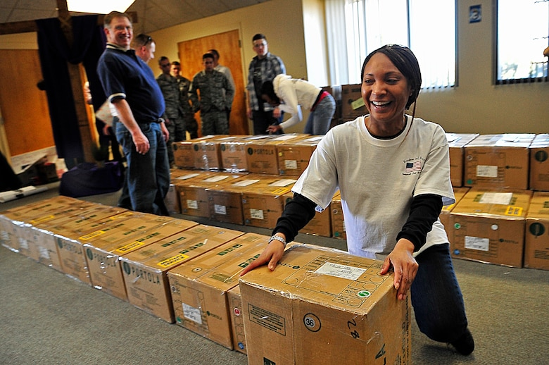 BUCKLEY AIR FORCE BASE, Colo. -- Master Sgt. Derinda Johnson, 460th Space Wing first sergeant, volunteers with Hearts Across the Miles March 14. Volunteers from Buckley Air Force Base and the local community came together to pack more than 300 cases of cookies. (U.S. Air Force photo by Staff Sgt. Kathrine McDowell)