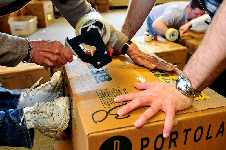 BUCKLEY AIR FORCE BASE, Colo. -- Volunteers from Buckley Air Force Base and the local community package boxes of cookies for Hearts Across the Miles March 14. These cookies will be shipped to U.S. troops deployed in Iraq and Afghanistan. (U.S. Air Force photo by Staff Sgt. Kathrine McDowell)