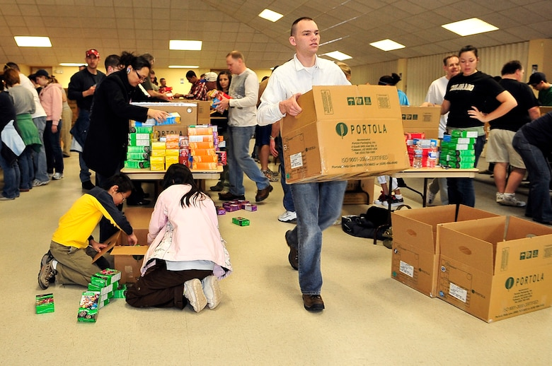 BUCKLEY AIR FORCE BASE, Colo. -- Senior Airman James Swann, 460th Space Communications Squadron, volunteers at a cookie drive for Hearts Across the Miles March 14. Airman Swann helped package more than 300 boxes of cookies for deployed U.S. troops. (U.S. Air Force photo by Staff Sgt. Kathrine McDowell)