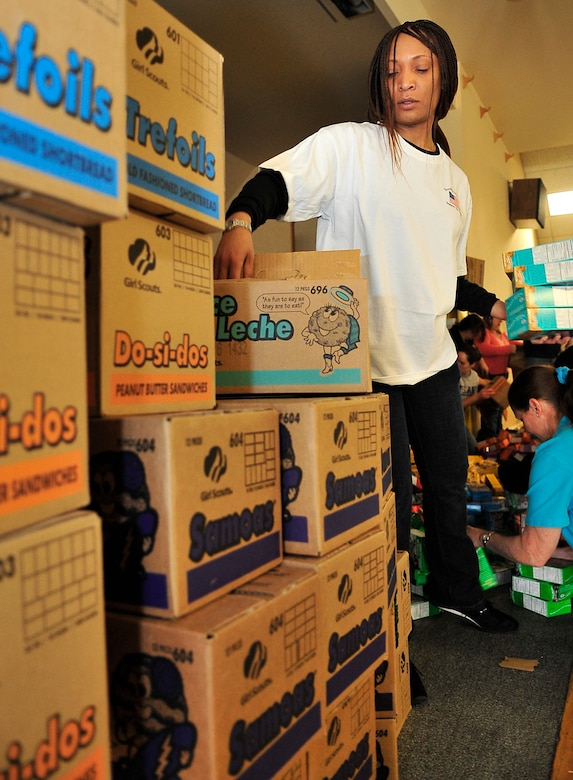 BUCKLEY AIR FORCE BASE, Colo. -- Master Sgt. Derinda Johnson, 460th Space Wing first sergeant, volunteers for Hearts Across the Miles March 14. Volunteers from Buckley Air Force Base and the local community came together to package more than 300 cases of cookies for deployed U.S. troops. (U.S. Air Force photo by Staff Sgt. Kathrine McDowell)