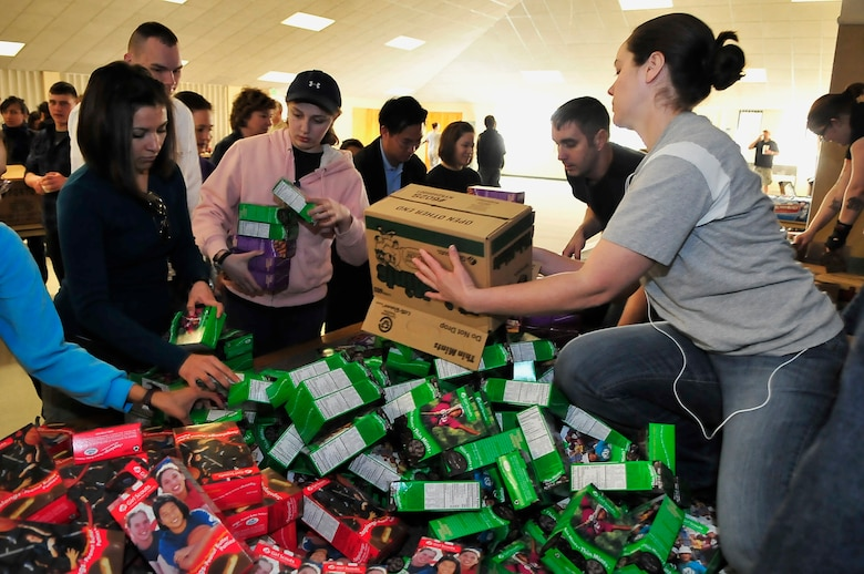 BUCKLEY AIR FORCE BASE, Colo. -- Tech. Sgt. Jill LaVoie, 460th Space Wing Public Affairs superintendent, helps sort boxes of cookies for Hearts Across the Miles March 14. Hearts Across the Miles is a non-profit organization that utilizes volunteer support to send care packages to deployed troops in Iraq and Afghanistan. (U.S. Air Force photo by Staff Sgt. Kathrine McDowell)