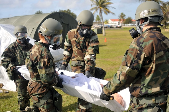 ANDERSEN AIR FORCE BASE, Guam - Participants in the Wing Abilitiy To Survive and Operate Rodeo carry a simulation casualty here March 30 2010. Partcipants in the rodeo took part in several exercises to include PAR sweeps, decontamination, and M-16 disassembly and reassembly.