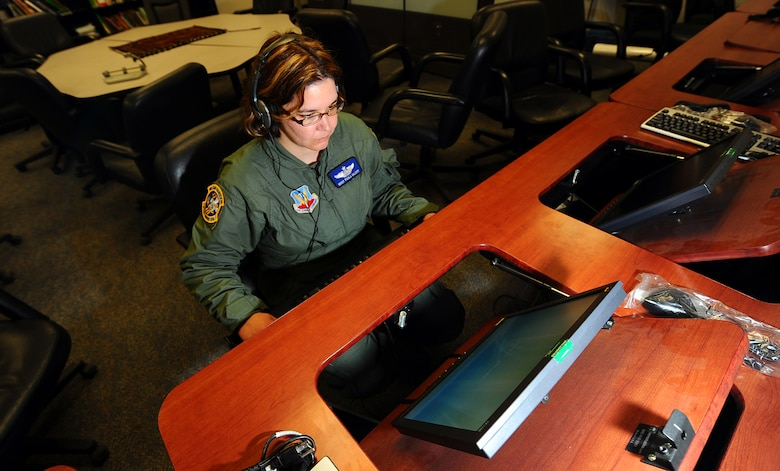 OFFUTT AIR FORCE BASE, Neb. -- Master Sgt. Paula Malott, an Arabic linguist and chief of Standardization and Evaluations with the 97th Intelligence Squadron, utilizes training software at the Language Learning Center here March 31 to maintain language proficiency. Sergeant Malott has spent her 20-plus year career with the Air Force as a linguist and has deployed more than 20 times in support of contingency operations. U.S. Air Force photo by Josh Plueger