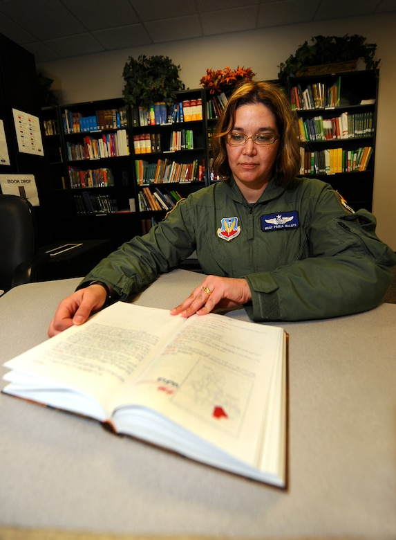 OFFUTT AIR FORCE BASE, Neb. -- Master Sgt. Paula Malott, an Arabic Linguist and chief of Standardization and Evaluations with the 97th Intelligence Squadron, reads a book written in Arabic at the Language Learning Center here March 31. Linguists like Sergeant Malott utilize the LLC and its many resources to maintain language proficiency. Sergeant Malott has spent her 20-plus year career with the Air Force as a linguist and has deployed more than 20 times in support of contingency operations. U.S. Air Force photo by Josh Plueger