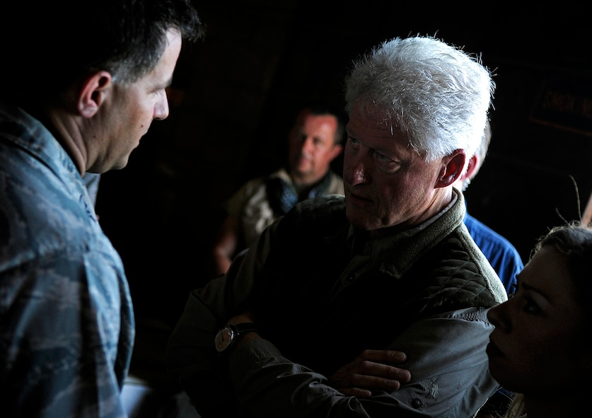 Former U.S. President Bill Clinton discusses relief efforts with U.S. Air Force Col. Buck Elton, commander of Special Operations Command South Forward-Haiti, Jan. 18 in Port-au-Prince, Haiti. Clinton, the U.S. envoy to Haiti, is surveying damage caused by the earthquake that devastated the city Jan. 12, and relief efforts in support of the natural disaster. (U.S. Air Force photo by Master Sgt. Russell E. Cooley IV/Released)