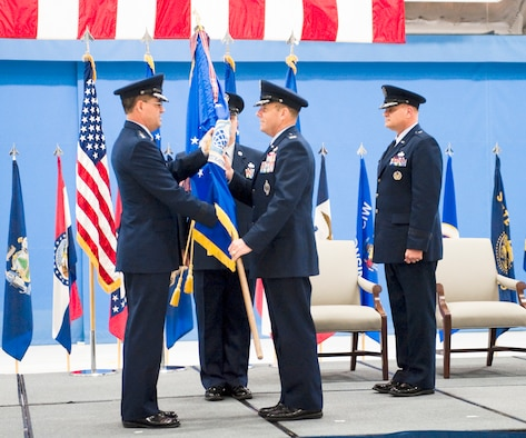 ANDREWS AIR FORCE BASE, Md. -- Lieutenant General Marc E. Rodgers, Inspector General of the Air Force, passes  the Air Force Office of Special Investigations guidon to the incoming AFOSI commander, Col. Kevin J. Jacobsen, who assumed command of the field operating agency, April 6. (U.S. Air Force photo/Mike Hastings)
