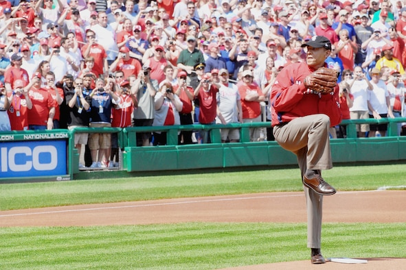 President Barack Obama throws out the ceremonial first pitch to start the baseball season for the Washington Nationals April 5, 2010, at Nationals Ball Park in Washington, D.C. The Washington Nationals honored military children, inviting nine children whose parents are deployed to step onto the infield with the starting players to see the president throw out the first pitch. (DOD photo/Navy Petty Officer 2nd Class William Selby)